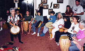 Simone LaDrumma leading a drum group